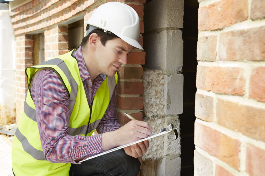 Architect Checking Insulation During House Construction